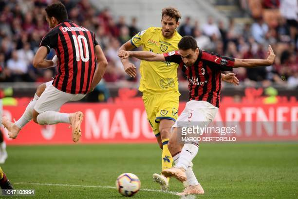 Milan's Italian midfielder Giacomo Bonaventura scores during the Italian Serie A football match between AC Milan and Chievo Verona on October 7 2018...