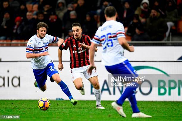 AC Milan's Italian midfielder Giacomo Bonaventura vies with Sampdoria's Polish defender Bartosz Bereszynski during the Italian Serie A football match...
