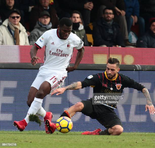 AC Milan's Ivoirian midfielder Franck Kessie fights for the ball with Benevento's Italian midfielder Vittorio Parigini during the Italian Serie A...