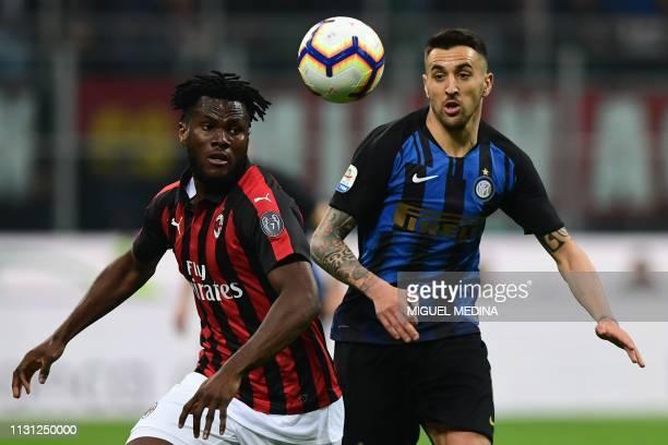 AC Milan's Ivorian midfielder Franck Kessie and Inter Milan's Uruguayan midfielder Matias Vecino go for the ball during the Italian Serie A football...