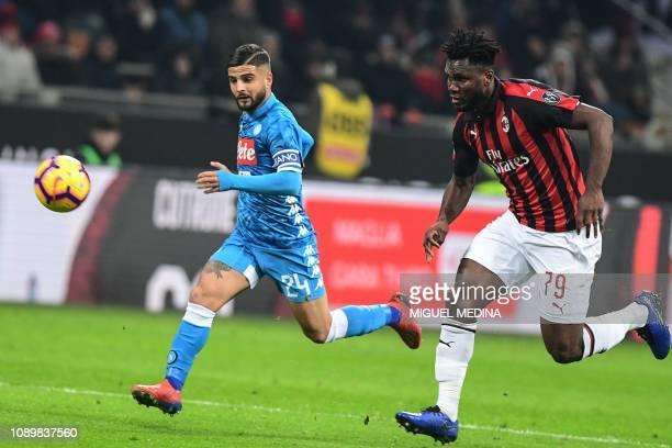 AC Milan's Ivorian midfielder Franck Kessie and Napoli's Italian forward Lorenzo Insigne go for the ball during the Italian Serie A football match AC...