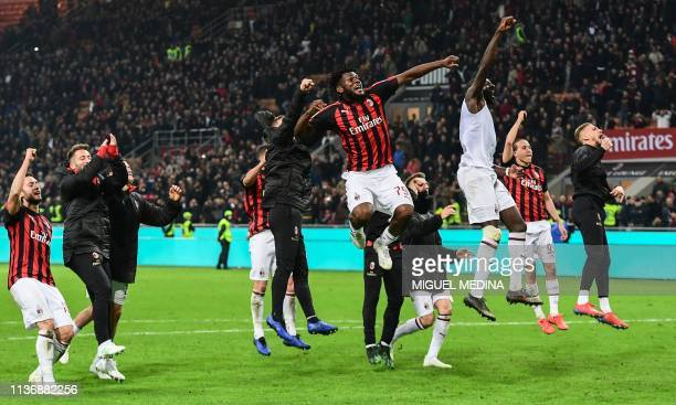 AC Milan's Ivorian midfielder Franck Kessie and teammates acknowledge the public at the end of during the Italian Serie A football match AC Milan vs...
