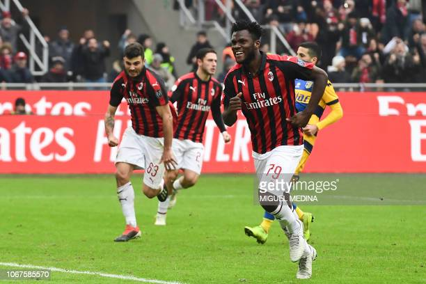 AC Milan's Ivorian midfielder Franck Kessie celebrates after scoring a penalty during the Italian Serie A football match AC Milan vs Parma on...