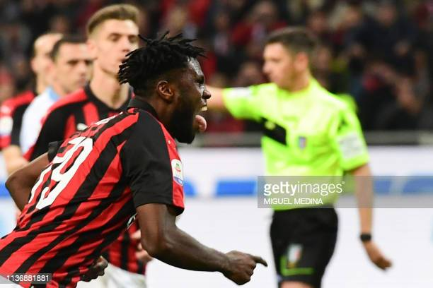 AC Milan's Ivorian midfielder Franck Kessie celebrates after scoring a penalty during the Italian Serie A football match AC Milan vs Lazio Rome on...