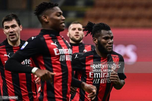 Milan's Ivorian midfielder Franck Kessie celebrates after scoring a last minute penalty during the Italian Serie A football match AC Milan vs Udinese...
