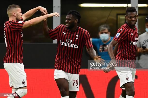 AC Milan's Ivorian midfielder Franck Kessie celebrates after scoring an equalizer during the Italian Serie A football match AC Milan vs Juventus...