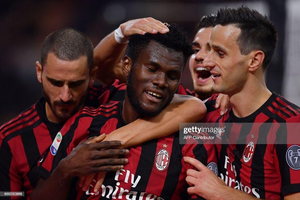 AC Milan's Ivorian midfielder Franck Kessie (C) celebrates after scoring during the Italian Serie A football match AC Milan vs Spal at San Siro stadium in Milan on September 20, 2017. /