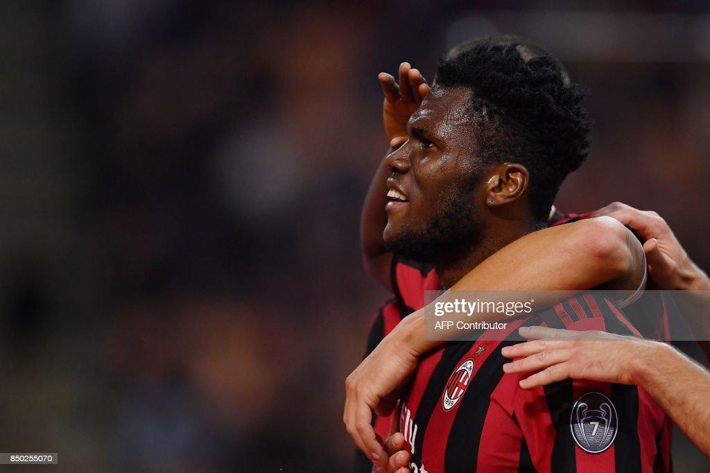 AC Milan's Ivorian midfielder Franck Kessie celebrates after scoring during the Italian Serie A football match AC Milan vs Spal at San Siro stadium in Milan on September 20, 2017. /