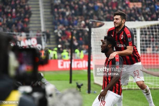AC Milan's Ivorian midfielder Franck Kessie celebrates with AC Milan's Italian forward Patrick Cutrone after scoring a penalty during the Italian...