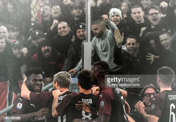AC Milan's Ivorian midfielder Franck Kessie celebrates with teammates after opening the scoring during the Italian Serie A football match Lazio Rome...
