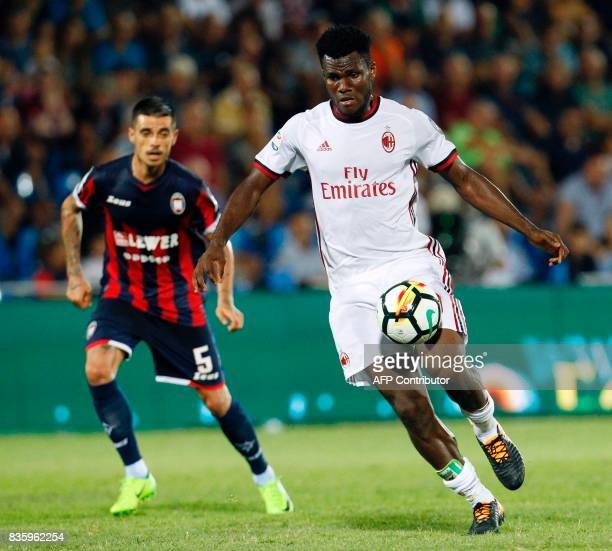 Milan's Ivorian midfielder Franck Kessie controls the ball in front of Crotone's Romanian forward Adrian Stoian during the Italian Serie A football...