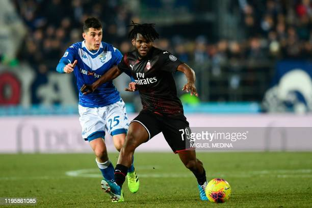Milan's Ivorian midfielder Franck Kessie fights for the ball with Brescia's Italian midfielder Dimitri Bisoli during the Italian Serie A football...