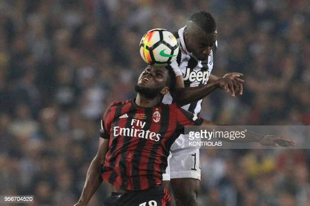 Milan's Ivorian midfielder Franck Kessie heads the ball as fighting with Juventus' French midfielder Blaise Matuidi during the Tim Italy Cup Final...