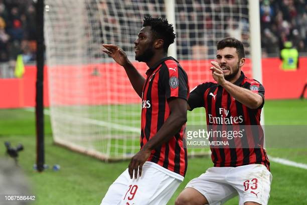 AC Milan's Ivorian midfielder Franck Kessie is congrtulated by AC Milan's Italian forward Patrick Cutrone after scoring a penalty during the Italian...