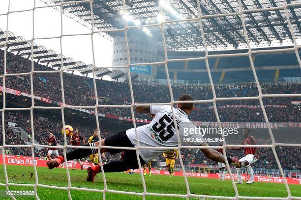 AC Milan's Ivorian midfielder Franck Kessie kicks and scores a penalty during the Italian Serie A football match between AC Milan and Parma at the...