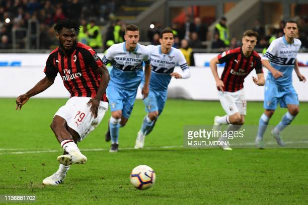 AC Milan's Ivorian midfielder Franck Kessie shoots to score a penalty during the Italian Serie A football match AC Milan vs Lazio Rome on April 13...