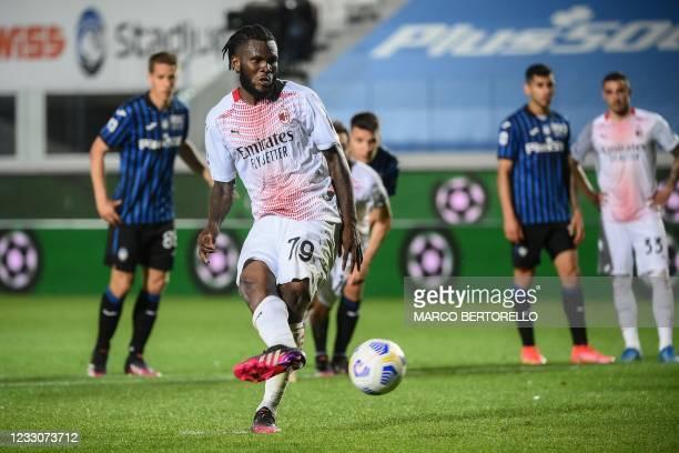 Milan's Ivorian midfielder Franck Kessie shoots to score his second penalty during the Italian Serie A football match Atalanta Bergamo vs AC Milan on...