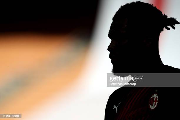 Milan's Ivorian midfielder Franck Kessie silhouetted against the sunlit stands during the Serie A match between AC Milan and AS Roma at Stadio...