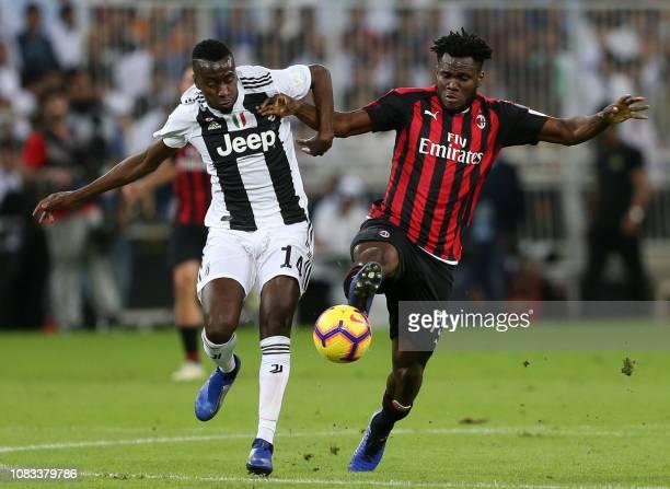 AC Milan's Ivorian midfielder Franck Kessie vies for the ball with Juventus' French midfielder Blaise Matuidi during their Supercoppa Italiana final...