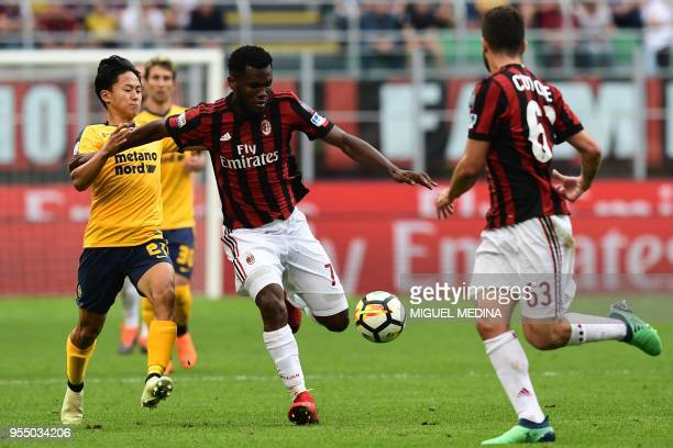 AC Milan's Ivorian midfielder Franck Kessie vies with Hellas Verona's South Korean forward SeungWoo Lee during the Italian Serie A football match...
