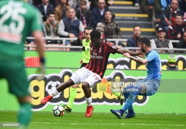 AC Milan's Ivorian midfielder Franck Kessie vies with Napoli's Albanian defender Elseid Hysaj during the Italian Serie A football match AC Milan vs...