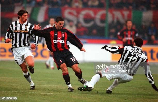AC Milan's Javi Moreno is tackled by Juventus' Mark Iuliano as Alessio Tacchinardi closes in