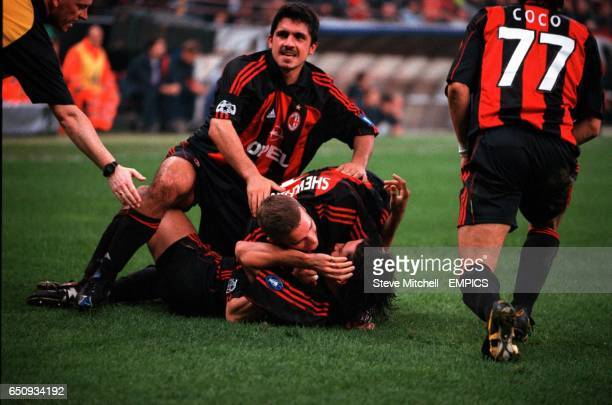 AC Milan's Jose Mari is mobbed by Gennaro Gattuso Andriy Shevchenko and Francesco Coco after scoring his team's third goal