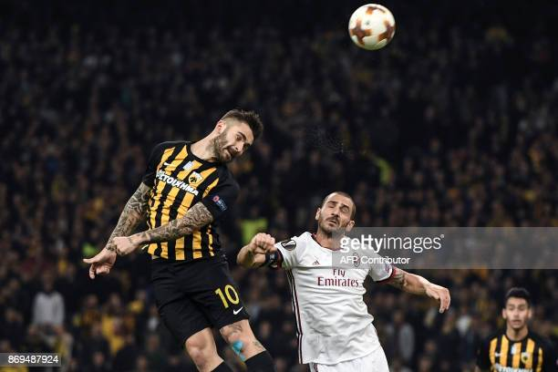 AC Milan's Leonardo Bonucci fights for the ball with AEK's Sergio Araujo during the UEFA Europa League Group D football match between AEK Athens and...