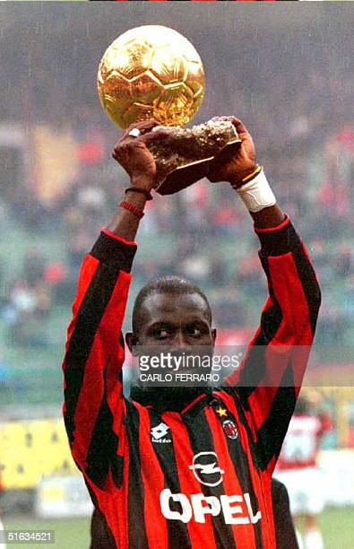 Milan's Liberian player George Weah holds up the Golden Ball award he recently received after the Italian league match between Milan and Sampdoria 07...