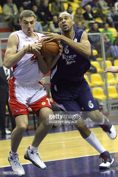 Milan's Lituanian player Mindaugas Katelynas vies for the ball with Istanbul's American player Loren Woods during their Euroleague group B basketball...
