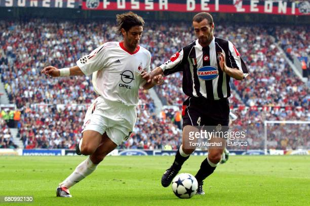 AC Milan's Manuel Rui Costa and Juventus' Paolo Montero battle for the ball