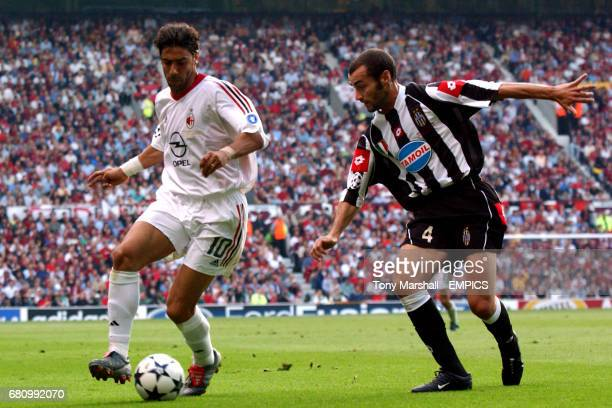 AC Milan's Manuel Rui Costa shields the ball from Juventus' Paolo Montero