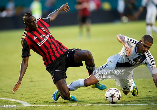 AC Milan's Mario Balotelli and the LA Galaxy's Leonardo go for the ball during the 2013 International Champions Cup match between the LA Galaxy and...