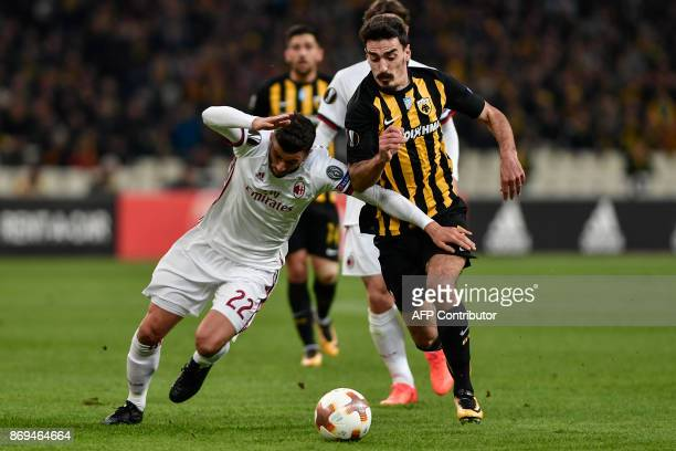 AC Milan's Mateo Musacchio vies for the ball with AEK's Lazaros Christodoulopoulos during the UEFA Europa League Group D football match between AEK...