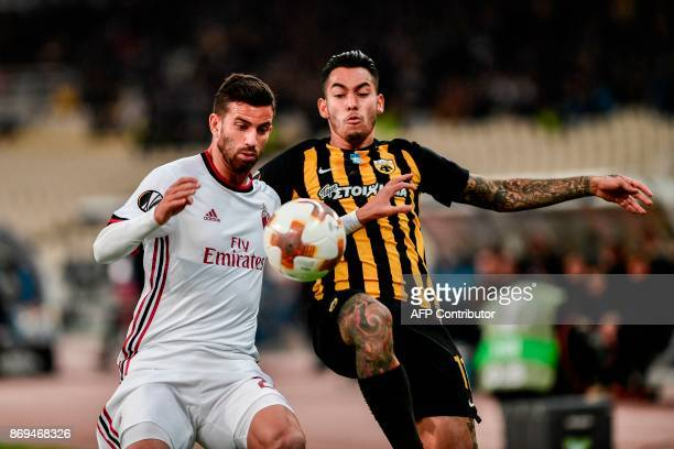 AC Milan's Mateo Musacchio vies for the ball with AEK's Sergio Araujo during the UEFA Europa League Group D football match between AEK Athens and AC...