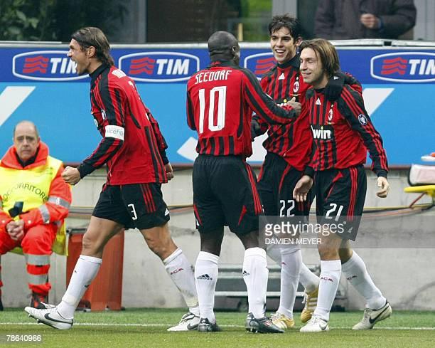 AC Milan's midfielder Andrea Pirlo is congratulated by AC Milan's Brazilian midfielder Kaka AC Milan's Dutch midfielder Clarence Seedorf and AC...
