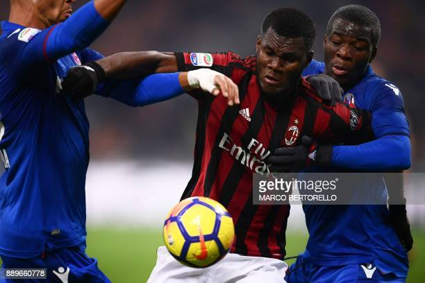 AC Milan's midfielder Franck Kessie from Ivory Coast fights for the ball with Bologna's midfielder Godfred Donsah from Ghana during the Italian Serie...