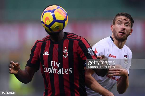 AC Milan's midfielder Franck Kessie from Ivory Coast fights for the ball with Crotone's midfielder Marcus Christer Rohden of Swedenduring the Italian...