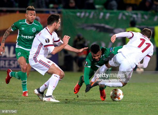 AC Milan's midfielder Franck Kessie vies for the ball with Ludogorets' defender Cicinho during the UEFA Europa League round of 32 firstleg football...