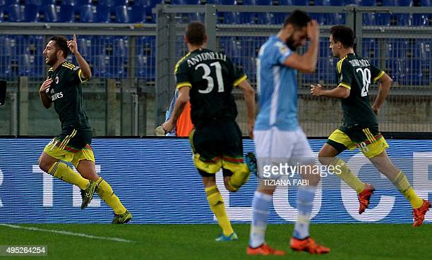 AC Milan's midfielder from Italy Andrea Bertolacci celebrates after scoring during the Italian Serie A football match between Lazio and AC Milan at...