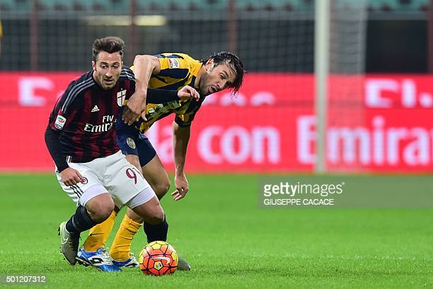 AC Milan's midfielder from Italy Andrea Bertolacci fights for the ball with Hellas Verona's forward from Italy Luca Toni during the Italian Seria A...