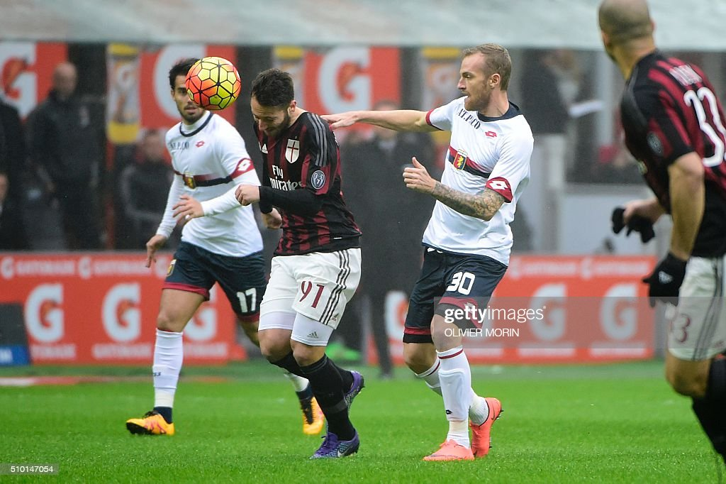 AC Milan's midfielder from Italy Andrea Bertolacci (L) fights for the ball with Genoa's midfielder from Argentina Tino Costa during the Italian Serie A football match AC Milan vs Genoa on February 14, 2016 at the San Siro Stadium stadium in Milan. MORIN