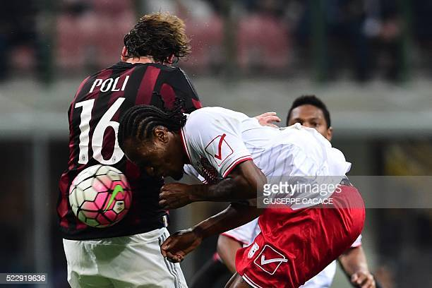 AC Milan's midfielder from Italy Andrea Poli fights for the ball with Carpi's forward from Nigeria Jerry Mbakogu during the Italian Serie A football...