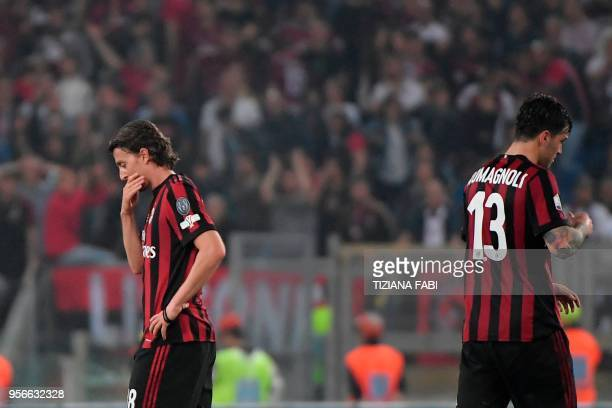 AC Milan's midfielder from Italy Riccardo Montolivo and AC Milan's defender from Italy Alessio Romagnoli react at the end of the Italian Tim Cup...