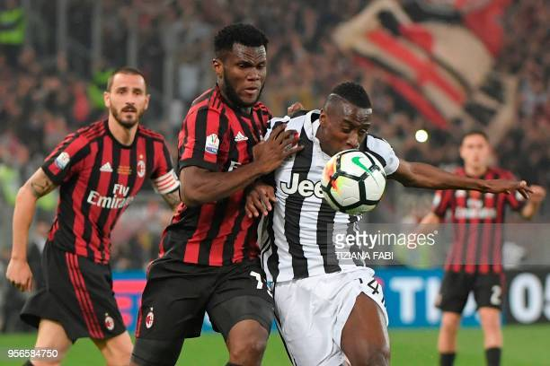 AC Milan's midfielder from Ivory Coast Franck Kessie fights for the ball with Juventus' midfielder from France Blaise Matuidi during the Italian Tim...