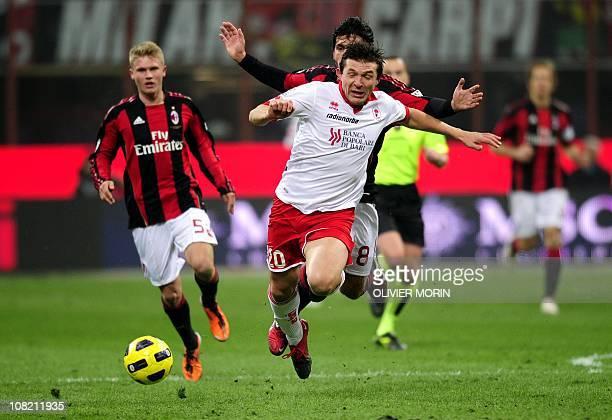 Milan's midfielder Gennaro Ivan Gattuso fights for the ball with Bari's Bielorussian forward Vitali Kutuzov during their Italian Cup last sixteen...