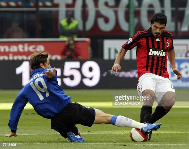 AC Milan's midfielder Gennaro Ivan Gattuso fights for the ball with Empoli's striker Nicola Pozzi 21 October 2007 during the Serie A football match...