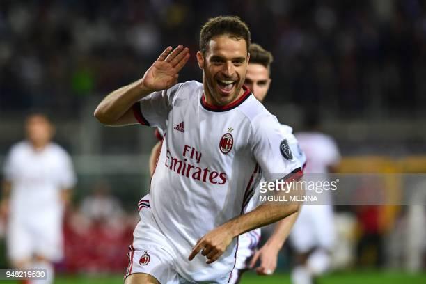 AC Milan's midfielder Giacomo Bonaventura celebrates after opening the scoring during the Italian Serie A football match Turin vs AC Milan at the...