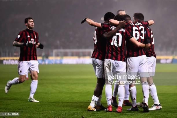 Milan's midfielder Giacomo Bonaventura celebrates with teammates after scoring during the Italian Serie A football match AC Milan Vs Lazio on January...
