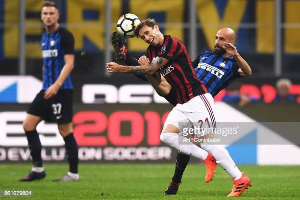 AC Milan's midfielder Lucas Biglia from Argentina fights for the ball with Inter Milan's midfielder Iglesias Borja Valero from Spain during the...